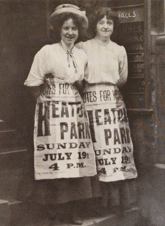 Suffragettes Mabel Capper (left) and Patricia Woodlock (right) wearing propagandist news-sheets as aprons, 1908